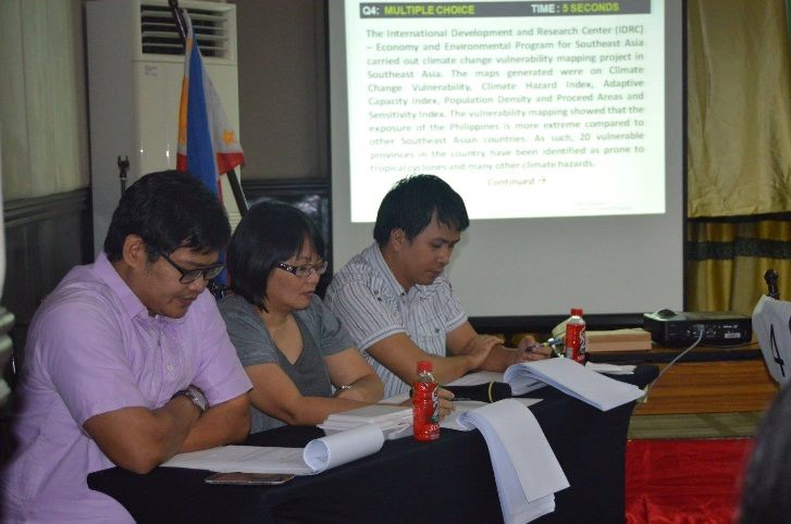 Assoc. Prof. Maria Paz Marquez sits as one of the judges  during the 2015 NCR Regional PopQuiz
