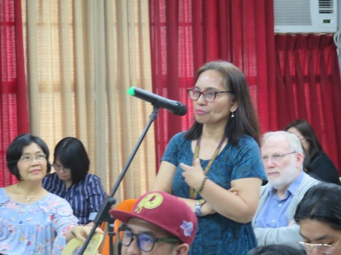 Dr. Nimfa B. Ogena poses a question to Dr. Ramiro