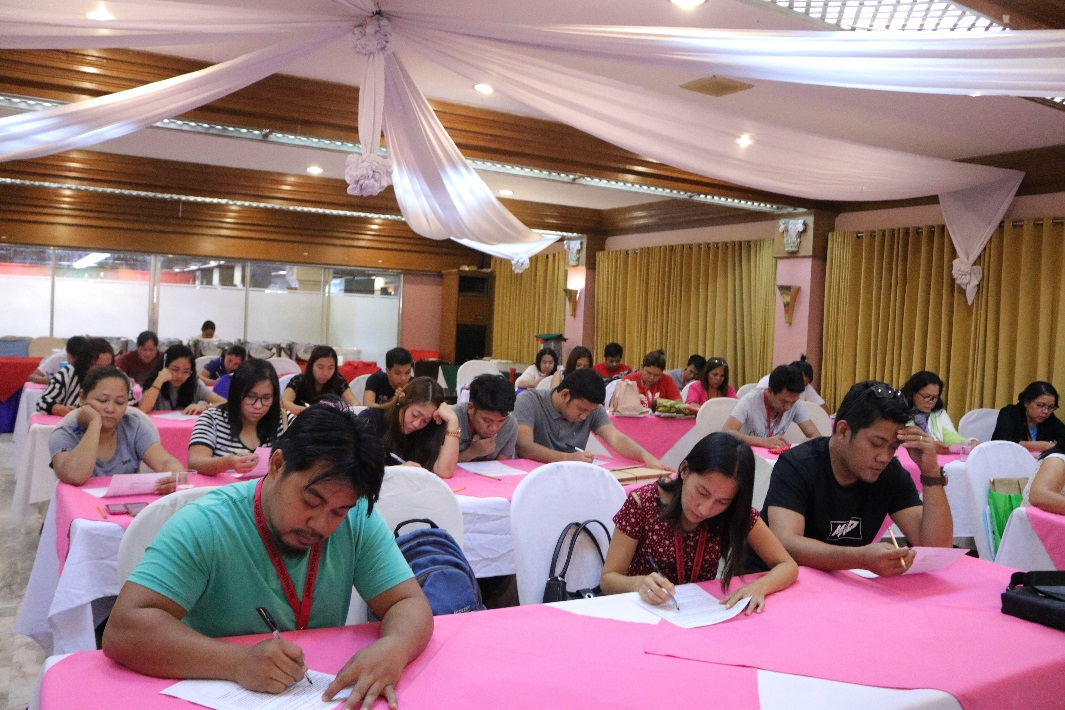Field workers for the adjacent Regions 10 and 13 take an exam which tests their comprehension skills of the survey materials during their NMS training in Cagayan de Oro[Cagayan de Oro City, Misamis Oriental;  in June 2018]